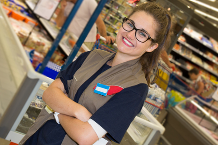 sales clerk: Portrait of a young sales clerk in a market store Stock Photo