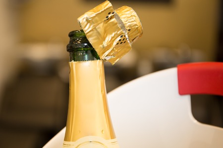 popping cork: Celebration theme a bottle of champagne after splashing