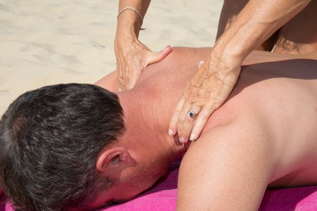 cranial: Massage therapy stretch head neck outdoor beach