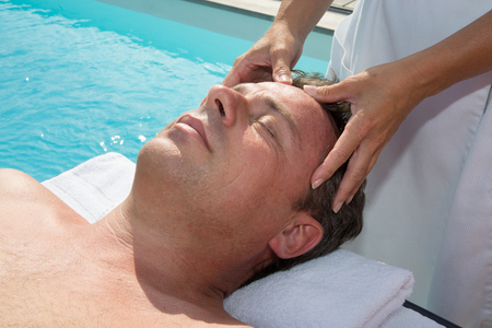 bioenergy therapy: Professional Reiki healer doing reiki treatment to a man