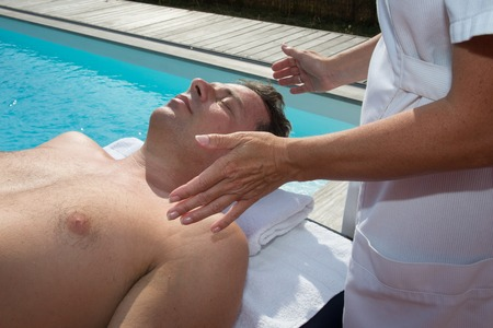 bioenergy therapy: Reiki healer doing reiki treatment to a man
