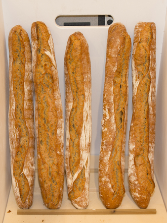 French baguettes in white wood basket in bakery Stock Photo