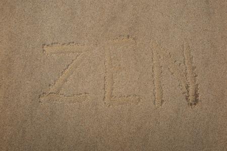 raked: Zen stone. Background on the sand written