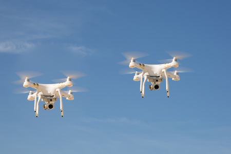 Image of two drones under blue sky