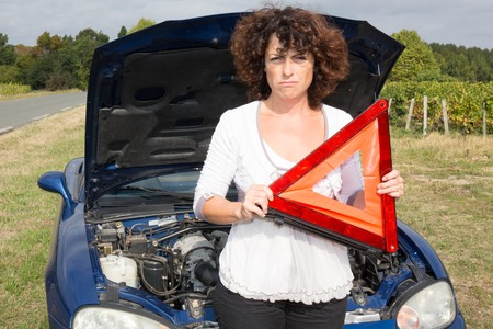 desperate: Woman near broken car desperate waiting for assistance Stock Photo