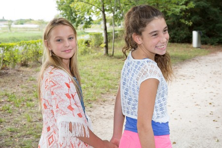Best Friends Forever - two 12 year old teenage girls holding hands