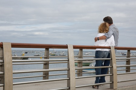 sea dock: Lovely and happy couple on a sea dock Stock Photo