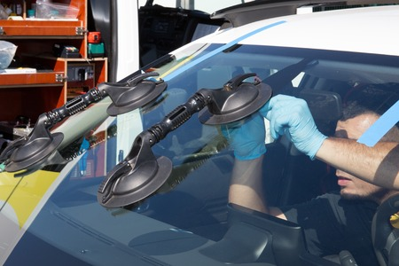 suction: Suction lifters on a windshield to change windscreen