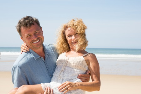 middle aged couple: Couple middle aged romance beach love island concept