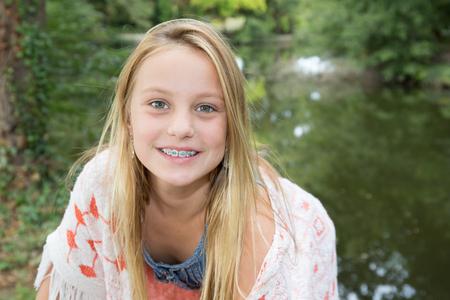 Portrait of pretty teen girl with dental braces. Stock Photo