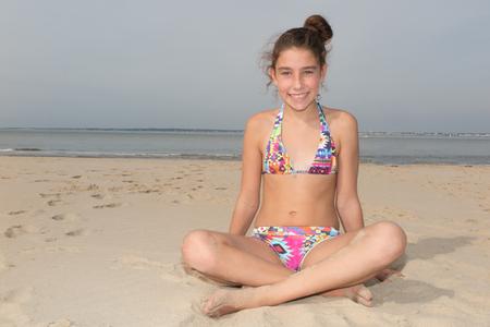 Young beautiful girl posing on the beach, wearing fashionable bikini Stock Photo
