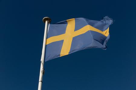 Flag of the Sweden against blue sky Stock Photo