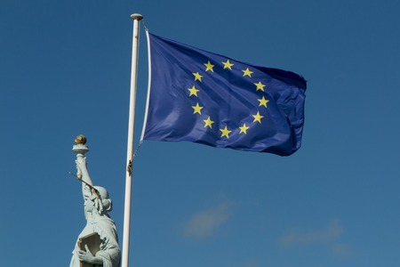 Statue of Liberty and european union against blue sky