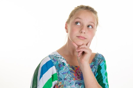 Little daydreamer. Cheerful little girl holding finger on chin Stock Photo