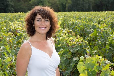 winemaker: Woman winemaker, in vineyard during wine harvest season in autumn Stock Photo