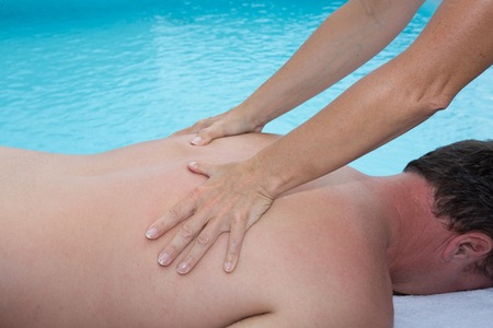 tuina: Female is doing chinese massage on man body in the spa salon Stock Photo