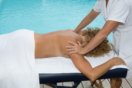 ze: Woman getting a back massage in spa center Stock Photo