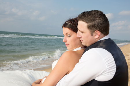 beautiful location: Cheerful groom and bride are looking under blue sky Stock Photo