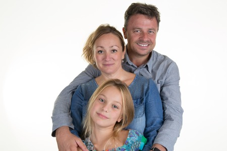 pre teen: Happy mother, father and young pre teen daughter - isolated