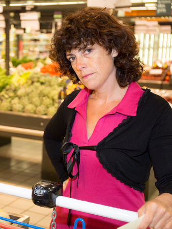 Woman in the supermarket looking at the camera