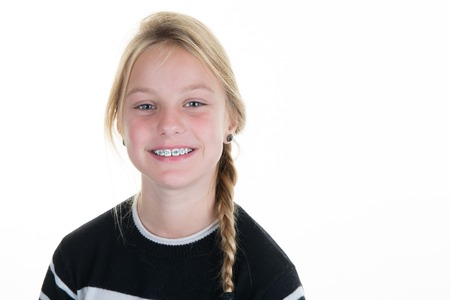 Pretty blond Teen or child girl isolated on white background Stockfoto