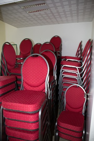 heaped: Chairs pile up, be stacked, be heaped in hotel business center, meeting room,