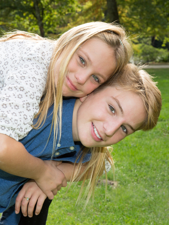 Loving blond brother and sister outdoors