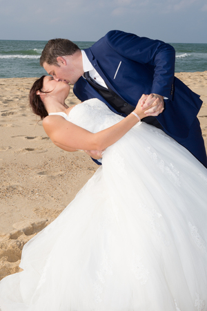 trash the dress: Newlyweds sharing a romantic moment at the beach