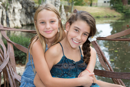 Preteen girls are the best of friends outdoor