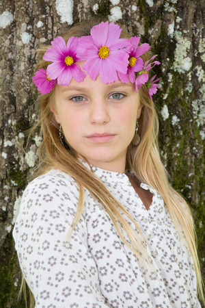 Blonde girl with a wreath of flowers on head