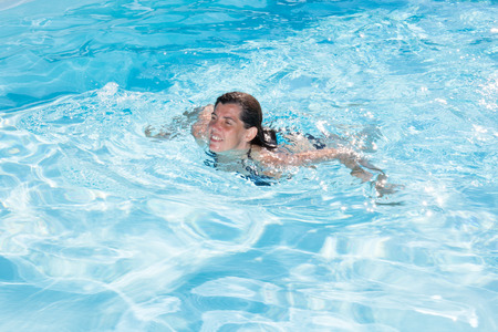 forties: forties woman in a swimming pool Stock Photo