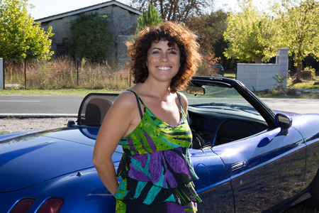 forties: forties woman with blue convertible car