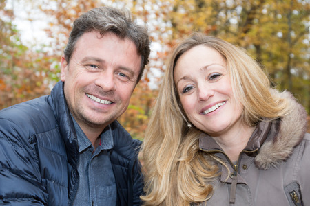 lovely couple forties in a park, blond woman Stockfoto