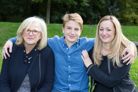 grand son: mother and son with grandmother in garden or green park
