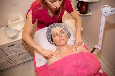 in center of beauty, woman forties have massage on neck