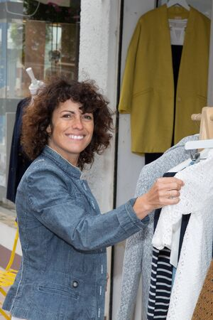 forties: a cut woman forties make shopping for dress Stock Photo