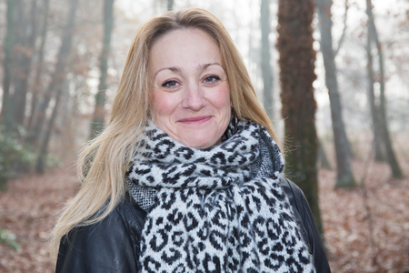 forties: in autumn, portrait of pretty forties woman in outdoor park