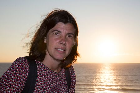 forties: sunset beach in ocean or sea with forties woman