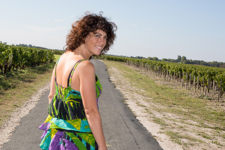 tourist woman in little road on summer near the vineyards in holidays