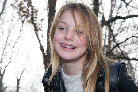 lovely blond girl in winter parc, smiling and happiness