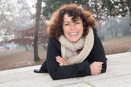 forties: forties woman portrait outdoors in winter smiling and happy