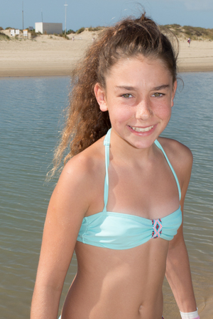Girl in bathing suit enjoys a beach holiday