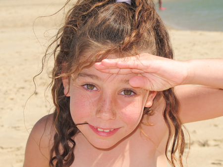 A girl enjoys herself on the sand during the summer holidays
