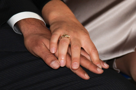 alliance: Close-up on the hands of the bride and groom after the wedding ceremony