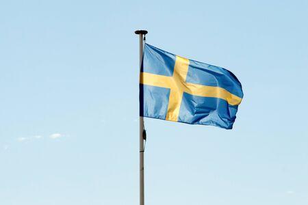 bandera de suecia: Flag of Sweden against a deep blue sky