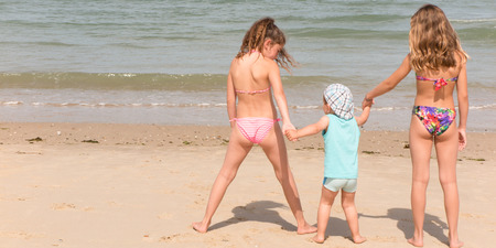 Back view of a happy children on beach Stock Photo