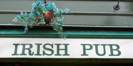 patrick: front of an Irish pub signboard in the street