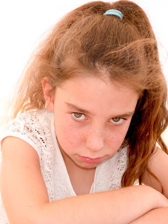 Portrait of a young girl with curly hair all sad and unhappy Stock Photo