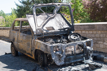 burned out: car after being burnt is all charring and black