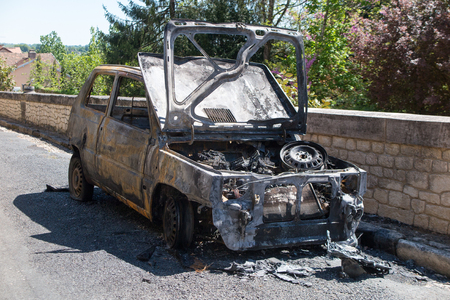 burned out: car caught fire in the street